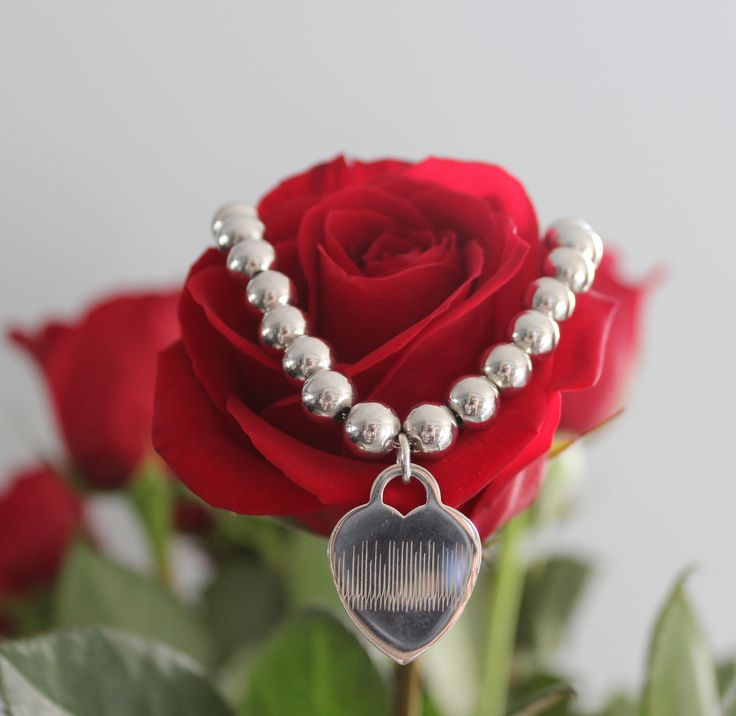 Have your ACTUAL HEARTBEAT personalized and engraved on this beautiful Sterling silver beaded bracelet with Heart Pendant. Download the free App on your smartphone to design your's.