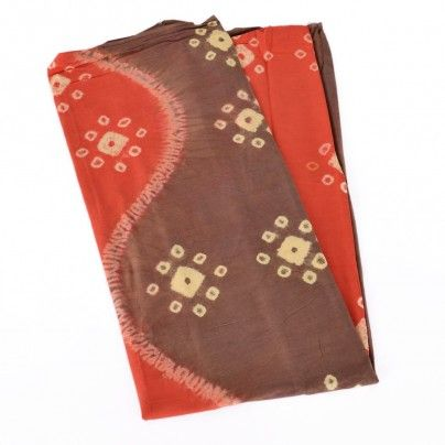 Jumputan cloth is one of unique cloth which motif is made by series of steps. First, the fabric is filled, then it is folded and put into coloring. The process created unique pattern with interesting brick red and brown colors. You can create your own creation with this cloth to match your fashionable style for kebaya or other outfit. $26.00