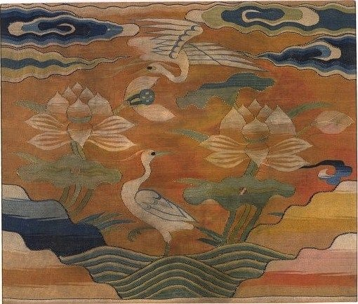 Rank badge, tapestry weave silk and metal-wrapped thread with a design of birds and lotus, China, Ming dynasty, 16th century. Height: 32 cm, Width: 35 cm.FE.11-1986.© V Images.