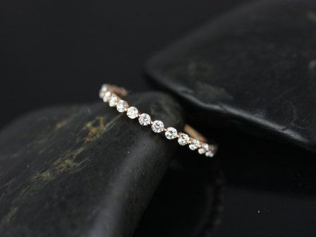 This simple yet interesting design is a must have classic! This ring is a slight twist the classic diamond eternity band! All stones used are only premium cut, fairly traded, and/or conflict-free! Ou