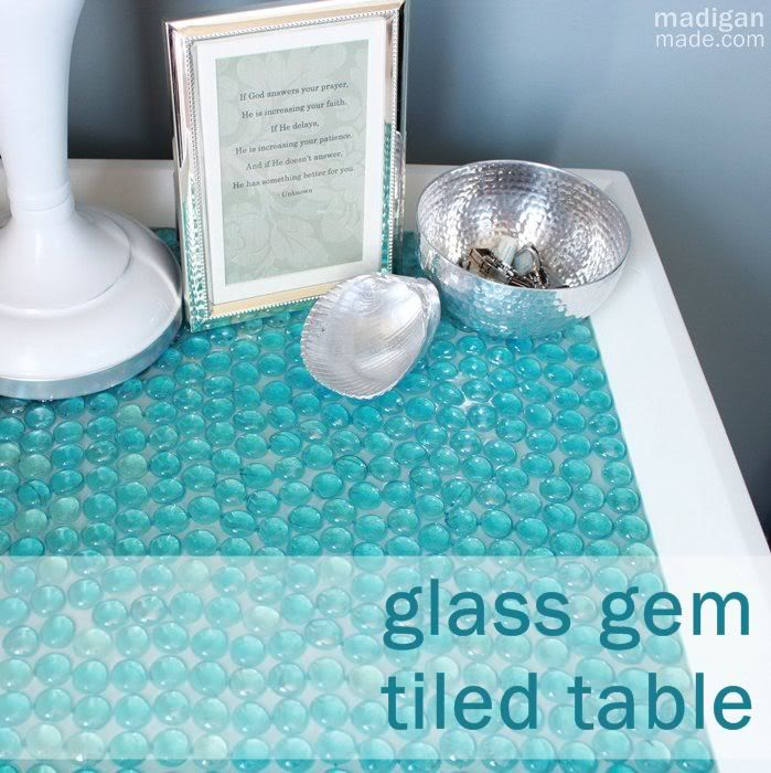 Tile a tabletop using blue glass gems and resin. ~via madiganmade.com