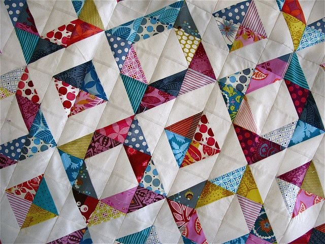 Another good scrap quilt half squares always background with a print