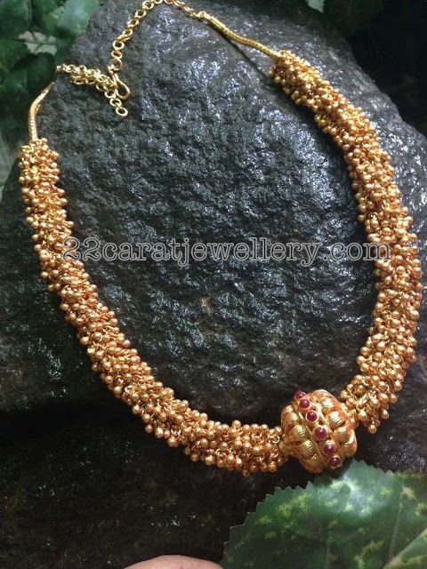 22 carat gold small swirls or muvvalu intricate long chain also called gajjela haram in Telugu. Antique work very large gold beads attach...