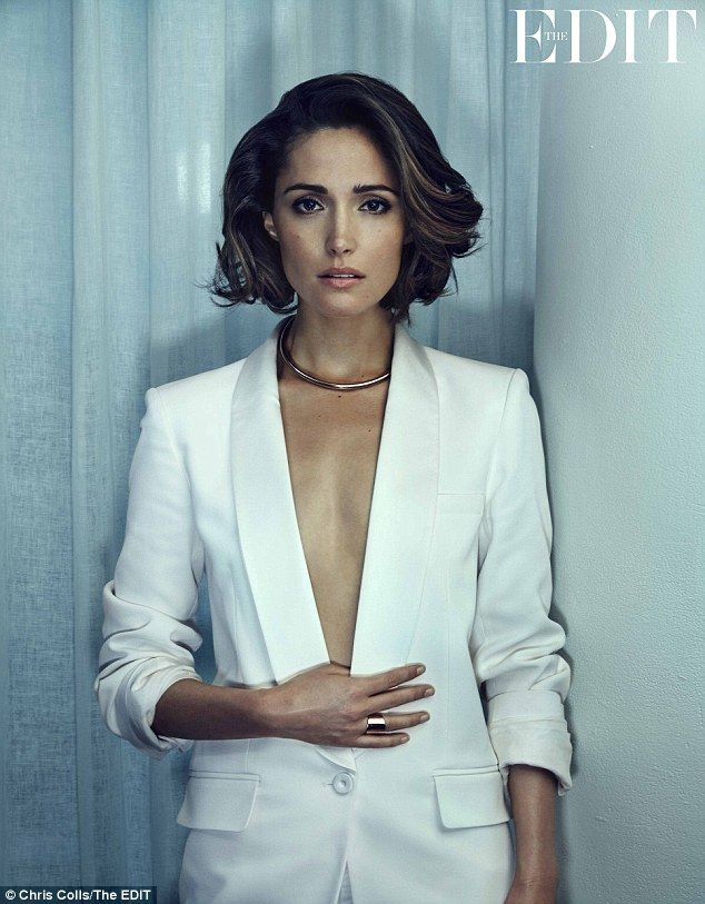 Frank interview: Rose Byrne looks incredible in a plunging white Vanessa Bruno blazer, paired with striking gold jewellery, as she poses for this week's edition of NET-A-PORTER's The Edit