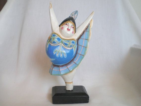 www.etsy.com/shop/ExtravaganzaBali  Wood carved dancer painted with acrylic colors. 25 cm. high. (9.84 inches). $17.90 USD