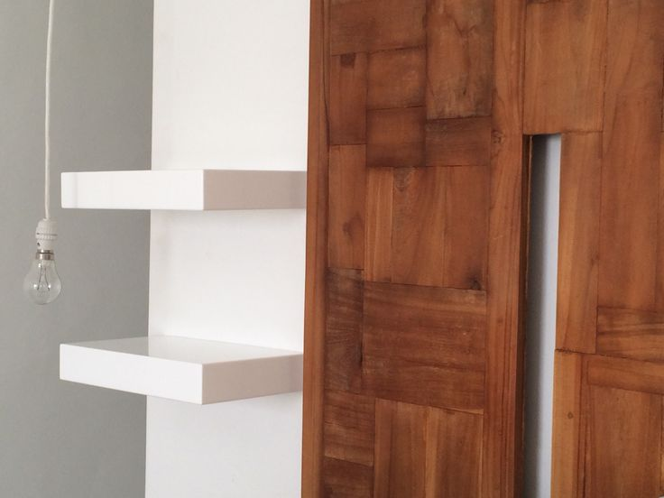 ODE shelves. Simple and beautiful next to a bare hanging bulb.