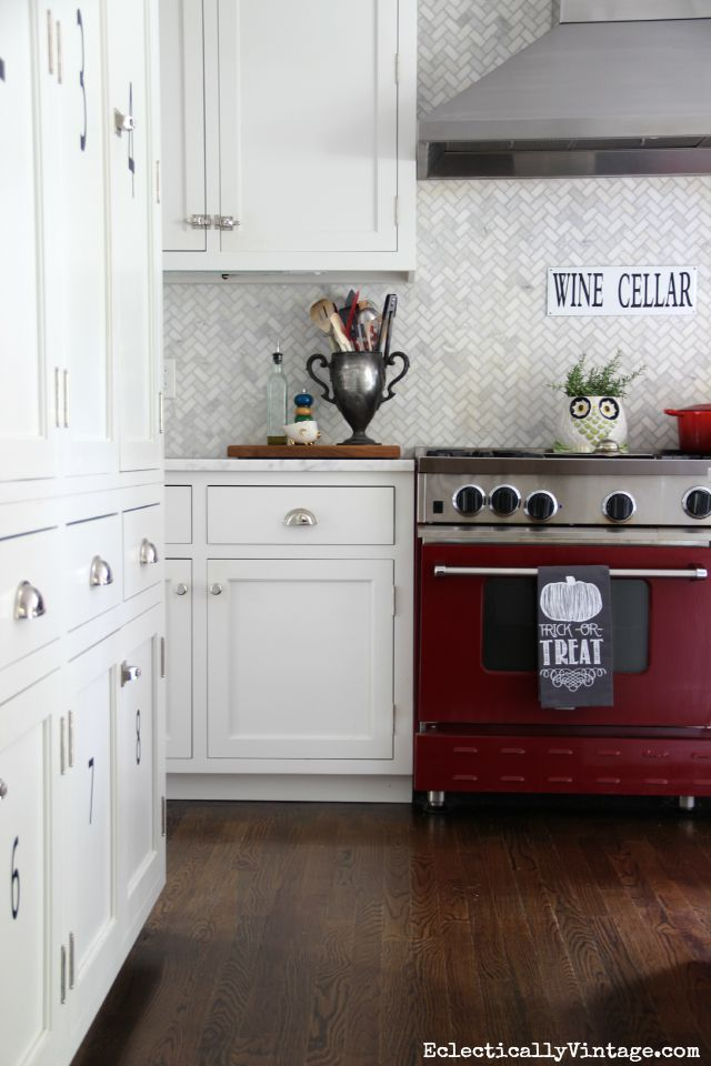Red stove in a white kitchen - love the herringbone backsplash eclecticallyvintage.com