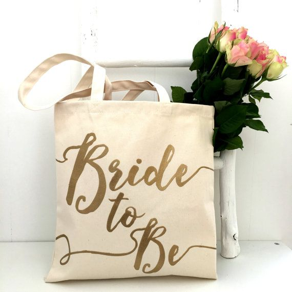 This luxury wedding bag is one of our best-sellers. It's made from a high-quality natural canvas and reads 'Bride to Be' in a gorgeous gold font!