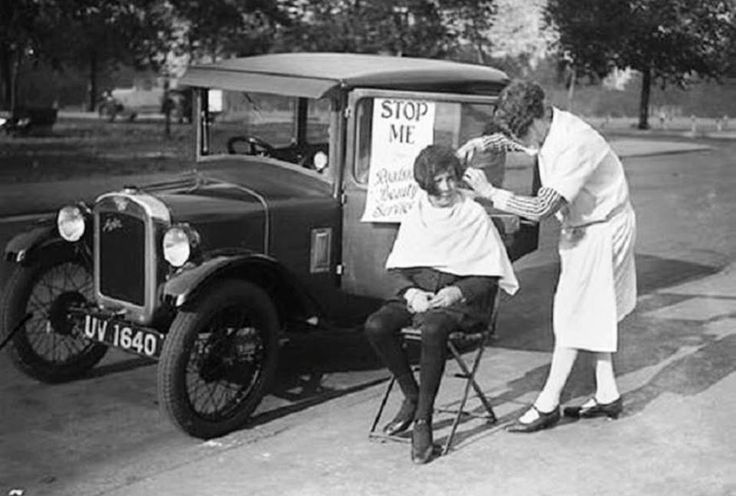 Stop me and get your hair cut. A mobile hairctiing service in London during the 20s