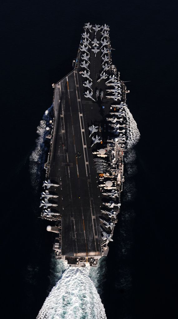 USS John C. Stennis (CVN 74) steams through the Straits of Hormuz. By Official U.S. Navy Imagery