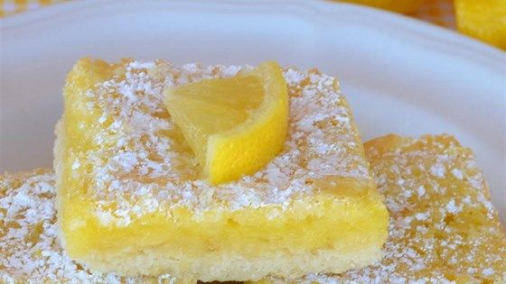 These tart, rich lemon bars need just seven common ingredients you probably already have, and are done in 55 minutes!