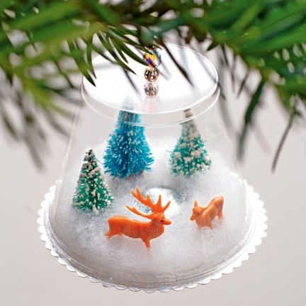 "Create a ""snow globe"" Christmas ornament with your kids using clear cups and figurines."
