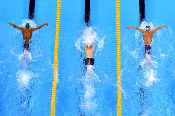 Michael Phelps Photos Photos - (L-R) Chad le Clos of South Africa, Tamas Kenderesi of Hungary and Michael Phelps of the United States compete in the second Semifinal of the Men's 200m Butterfly on Day 3 of the Rio 2016 Olympic Games at the Olympic Aquatics Stadium on August 8, 2016 in Rio de Janeiro, Brazil. - Swimming - Olympics: Day 3