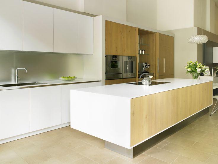 Systemat Range   Polar White Lacquer Matt Cabinetry   Designer White Corian    Natural Rough Cut
