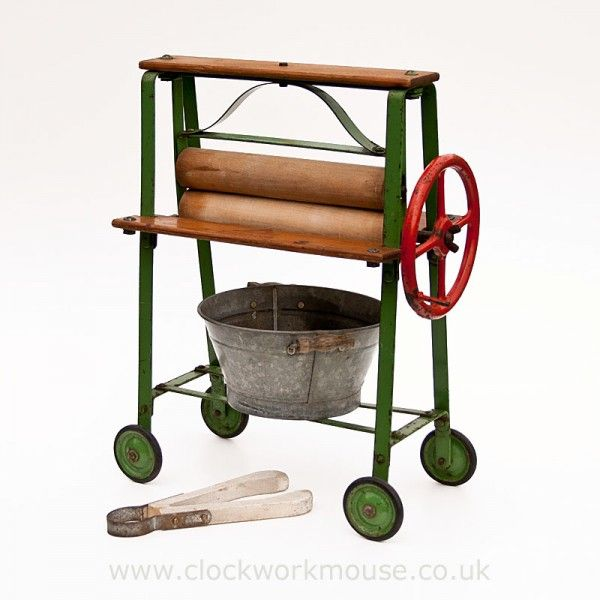 A fabulous vintage children's toy mangle by the famous English toymaker Triang and dating from circa 1950's.