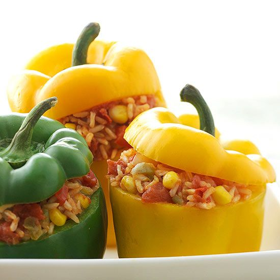 Make healthy stuffed peppers with our easy recipe! This meatless dish is full of flavor with tons of vegetables, brown rice and cilantro. Switch out the rice for quinoa for a high-protein dinner that is great for leftovers!