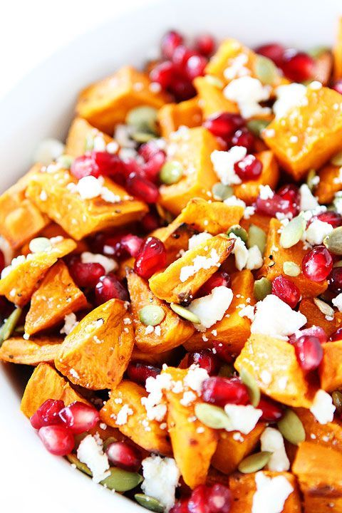 Sweet potato salad with pomegranates, feta cheese, pumpkin seeds and other lovely goodies. I've made this many a time and it is absolutely delicious.
