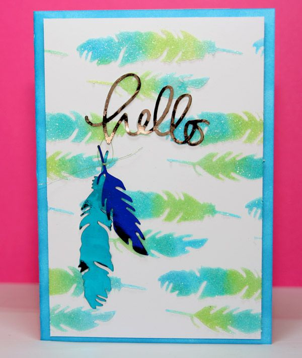 using Wendy Vecchi translucent paste with iridescerent glitter through a stencil made with Simon Says Stamp feather die, coloured with Distress ink