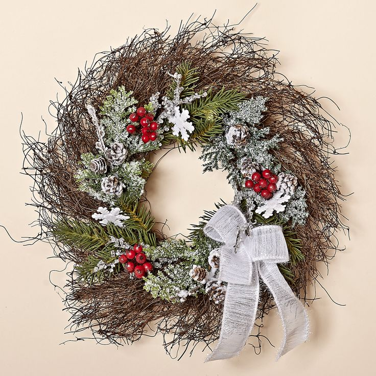 12 Inch Natural Twig Wreath with Frosted Greens, Red Berries, White Bow and Snowflakes. From the Snowy Christmas Colection