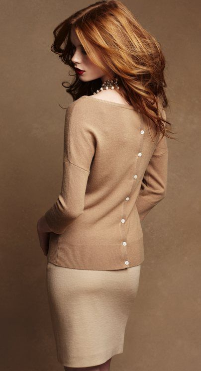 Love her hair....sweater with the buttons down the back