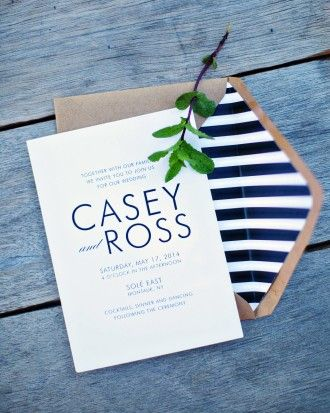 Confetti Grey designed Casey and Ross's invitation. The card popped against the envelope's black-and-white-striped lining and gold trim.