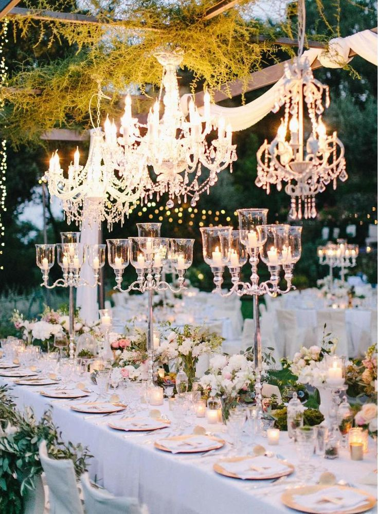 There is something romantic and magical about chandeliers outside to create the most romantic décor for a destination wedding.  #ClippedOnIssuu from Magnolia Rouge Issue 7 - Preview