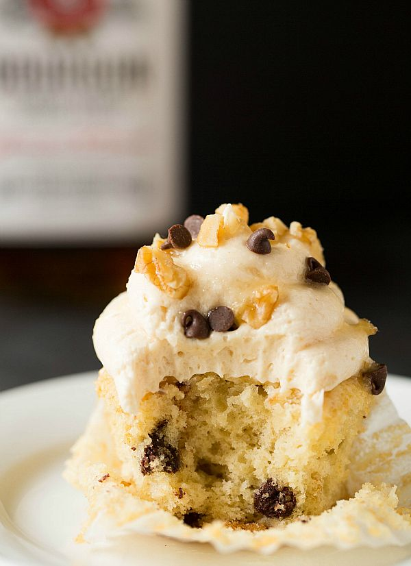 Kentucky Derby Pie Cupcakes - Butter-bourbon cake batter (sort of like rum cake, but with bourbon instead) that is loaded with chopped walnuts and chocolate chips, topped off with a vanilla-bourbon buttercream frosting, drizzled with bourbon-butter glaze, then garnished with more chopped walnuts and chocolate chips.