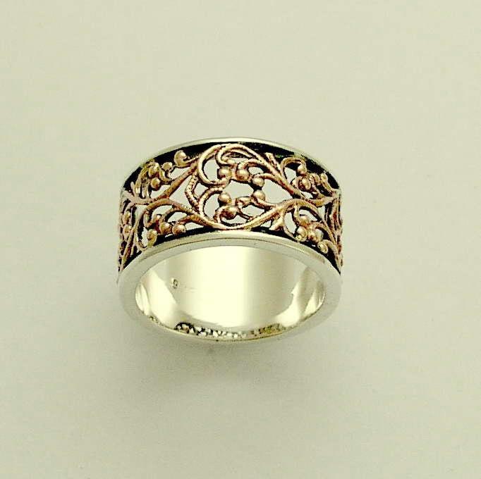 Sterling silver and rose gold filigree wedding band - Karma.. $248.00, via Etsy.