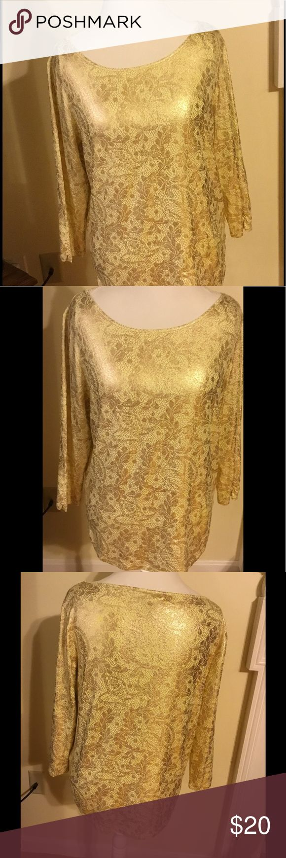 New Chico's Gold Long Sleeve Top (2) 12-14 Attractive Chico's Long Sleeve Top Sz 2 (12/14). Gold foil/shimmer, soft feeling,and has Stretch to it. Beautiful top never worn just hung in closet. Chico's Tops