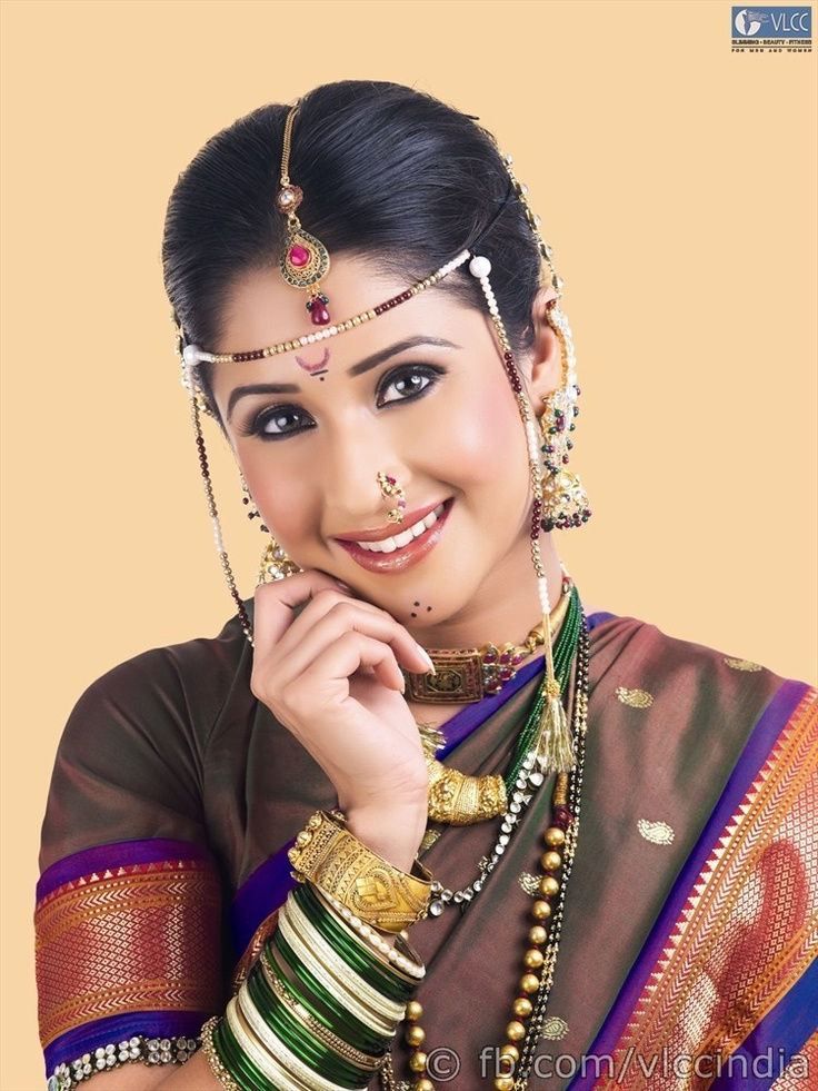 The traditional Maharashtrian look is brought about with a base eye shadow in neutral shades that can match all the 5 sari change that occur during the ceremonies. Dark kohl and deeply coloured lips are enhanced with a hint of bronze and gold. The hairs is done up in a long plait or a bun covered throughout with a trail of sweet smelling mogras.