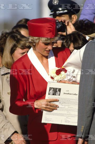 November 9 1985 Princess Diana,is given gifts by  royal fans  on arrival at Washington D.C airport