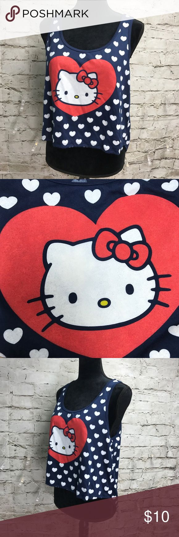 """Hello Kitty By Sanrio Tank Top SZ Large Hello Kitty by Sanrio size large. Navy blue with white hearts featuring Hello Kitty on the front. Great preowned condition. Please see the pictures for more details. Measurements from top of bust line to bottom is 12"""", arm pit to arm pit 18"""". Thank you for looking and I invite you to check out the rest of my closet for more great finds! Save 15% by bundling 2 or more items! Hello Kitty by Sanrio Tops Tank Tops"""