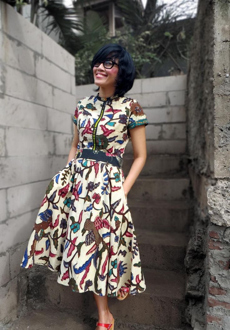 Wearing Batik Amarillis' Rive gauche dress, elizabeth and James glasses, and wooden shoes  from Chameleon clogs.