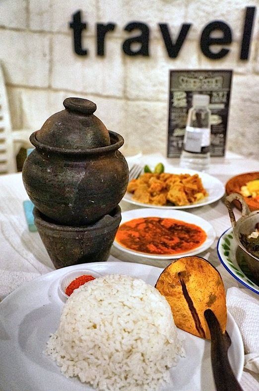 Traditional touch: Empal kendil, (beef in coconut gravy soup) presented in small clay jug called kendil. (Photo by Icha ...
