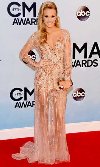 Carrie Underwood in a sheer, rose gold-colored concoction with crystal embellishments from Ralph & Russo Couture.