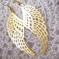 Très jolie boucles d'oreille en forme d'ailes, très tendance, doré laiton