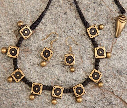 Handmade terracotta jewelry. Painted on black & gold. https://www.facebook.com/KavisTerracottajewellery