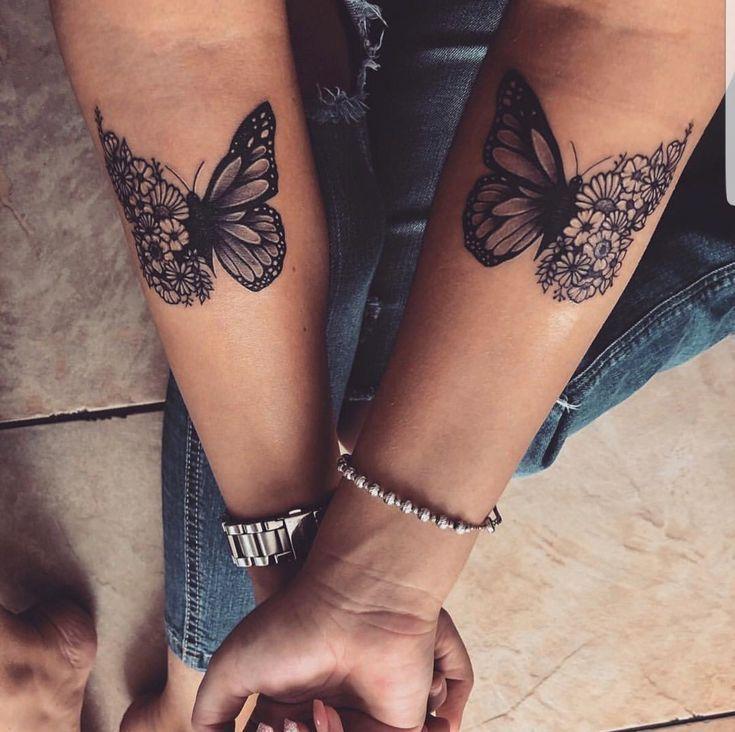 Schmetterling blüht Tätowierung