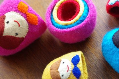 Felted nesting dolls. Pattern for purchase, however, the photos inspire me to do it myself...