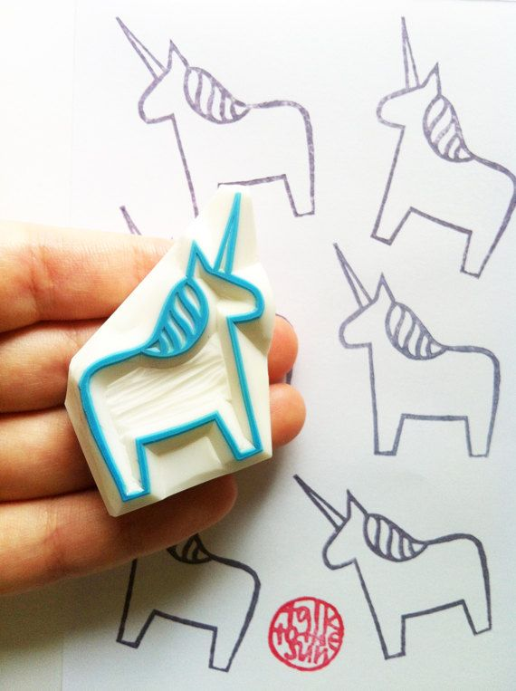 unicorn hand carved rubber stamp. dala horse by talktothesun