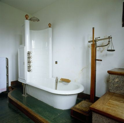 Photo Gallery For Website The Bathroom showing the bath plete with shower partment and old style weighing scales