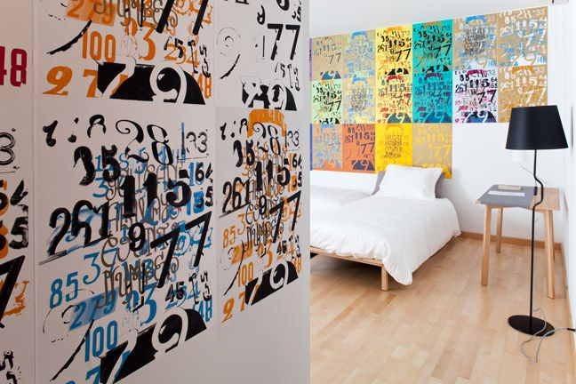 The Lisbonaire Apartments, available for holiday rental in Lisbon. Wall prints by Nuno Luz, inspired in Lisbon's door numbers.