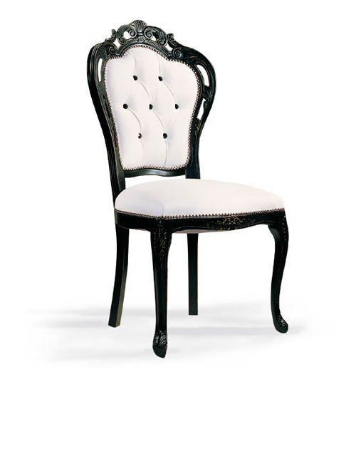 Diva Collection black and white leather Baroque dinning chair with button back upholstery. Hand carved from beech wood.