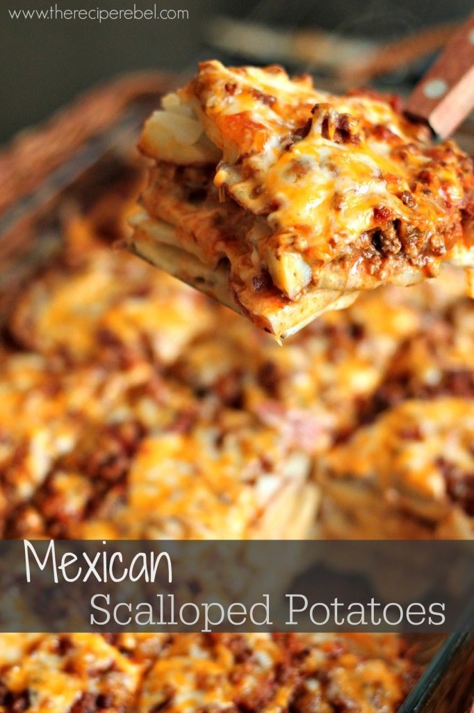 Mexican Scalloped Potatoes -- spicy taco beef and salsa, layered with creamy scalloped potatoes and cheese!