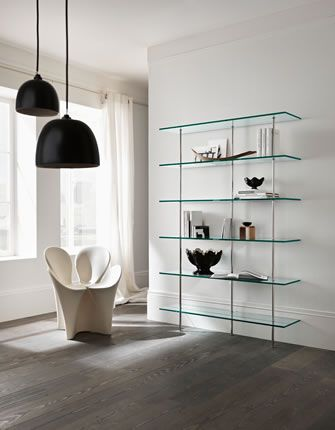 'Trasparenza' Wall-mounted modular bookcase with five or six shelves and metal supports with protected silver finish.