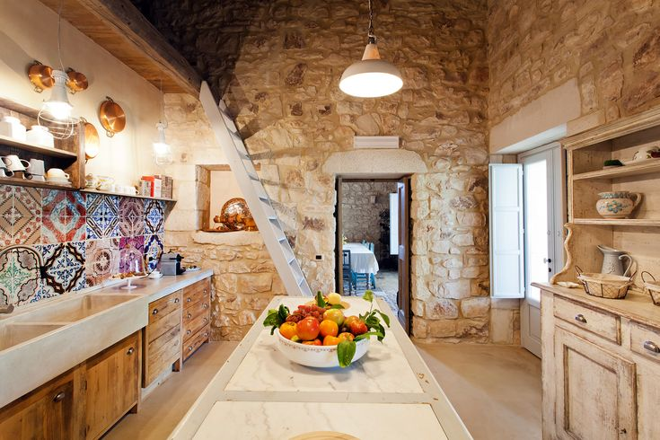 The characterful kitchen of Masseria d'Estia, with its beautiful Sicilian ceramics. Photography by Benedetto Tarantino.