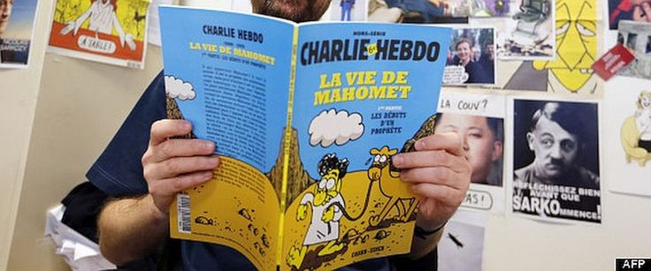 "BD ""halal"" de Charlie Hebdo sur la vie de mahomet - French satirical weekly Charlie Hebdo's publisher, known only as Charb, presents his new comic strip named ""La Vie de Mahomet"" (The life of Mohammed) in Paris on December 27, 2012. AFP PHOTO / FRANCOI..."