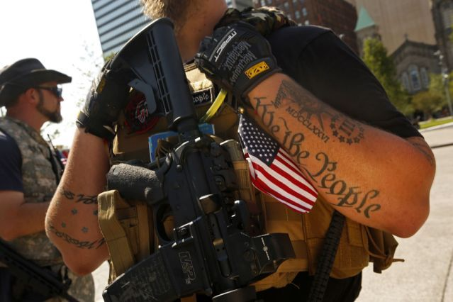 On the second day of the Republican National Convention, Ohio Minutemen gather in downtown Cleveland to express their feeling on the Second Amendment in Cleveland, July 18, 2016. (Photo: Carolyn Cole/Los Angeles Times via Getty Images)