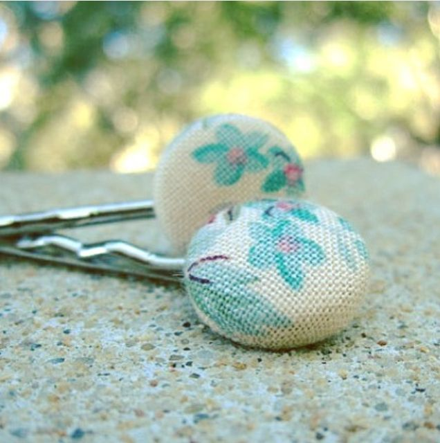 Fabric covered button hair clips (bobby pin style), featuring tiny aqua and pink flower patterns. 1 pair for $7.00 by www.zoesbuttonemporium.etsy.com and available at the #etsymadelocal Markets, Canberra.