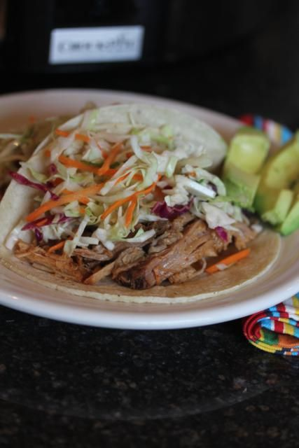 Slow cooked pulled pork with mexican coleslaw - use cabbage, shredded carrots, and jalapenos for the slaw mix.